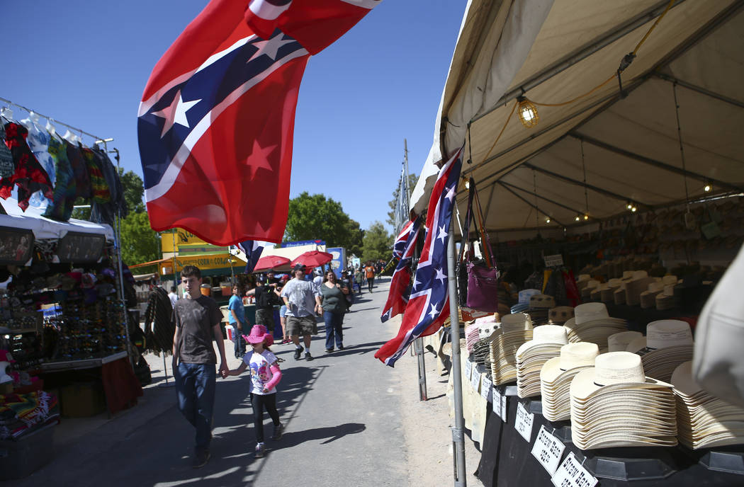 Attendees browse through vendors during the first day of the Clark County Fair and Rodeo in Logandale on Wednesday, April 12, 2017. Chase Stevens Las Vegas Review-Journal @csstevensphoto