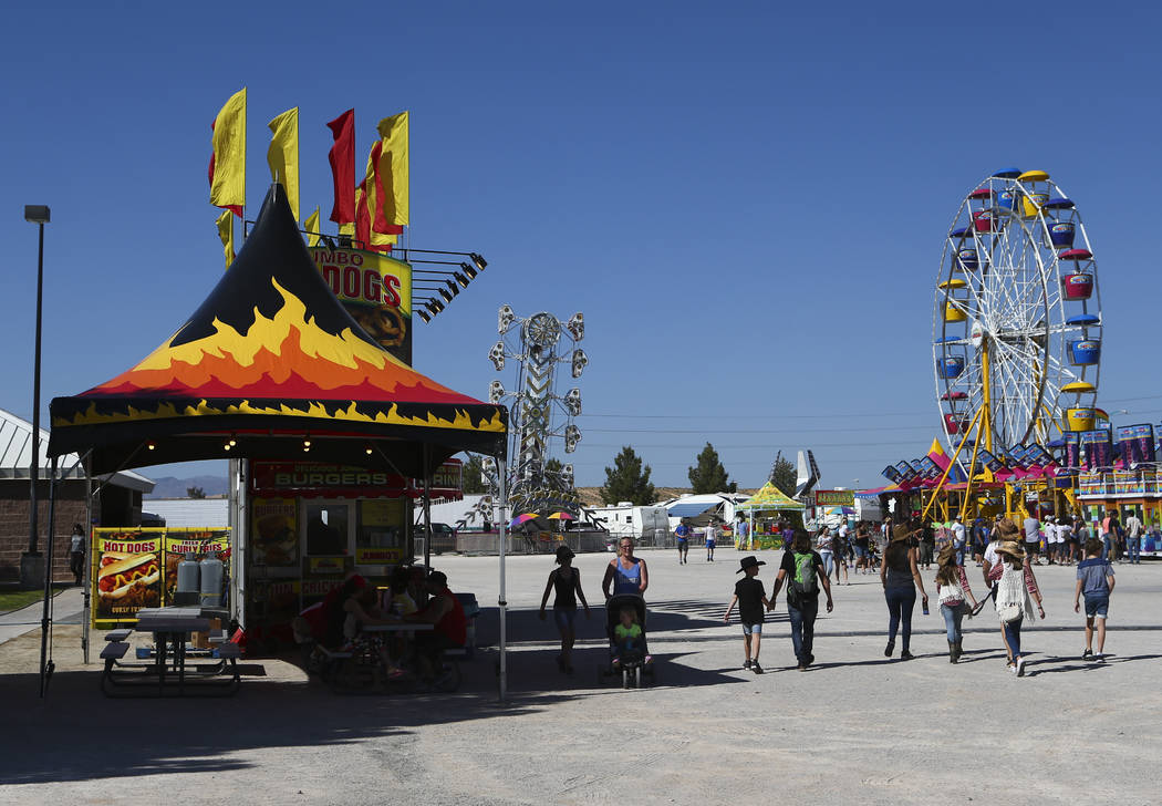 Attendees make their way to the carnival area during the first day of the Clark County Fair and Rodeo in Logandale on Wednesday, April 12, 2017. Chase Stevens Las Vegas Review-Journal @csstevensphoto