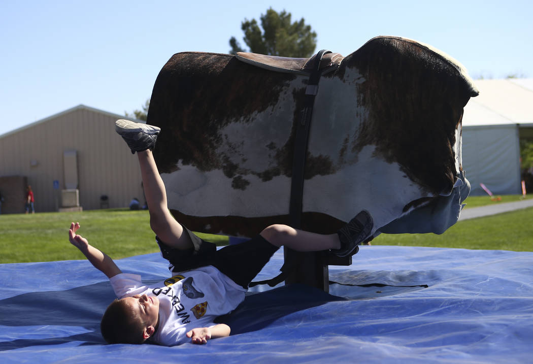 Seven-year-old Brandon LeBlanc of Las Vegas is knocked off by a mechanical bull during the first day of the Clark County Fair and Rodeo in Logandale on Wednesday, April 12, 2017. Chase Stevens Las ...