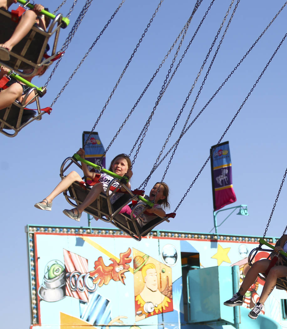 Attendees go on a carnival ride during the first day of the Clark County Fair and Rodeo in Logandale on Wednesday, April 12, 2017. Chase Stevens Las Vegas Review-Journal @csstevensphoto