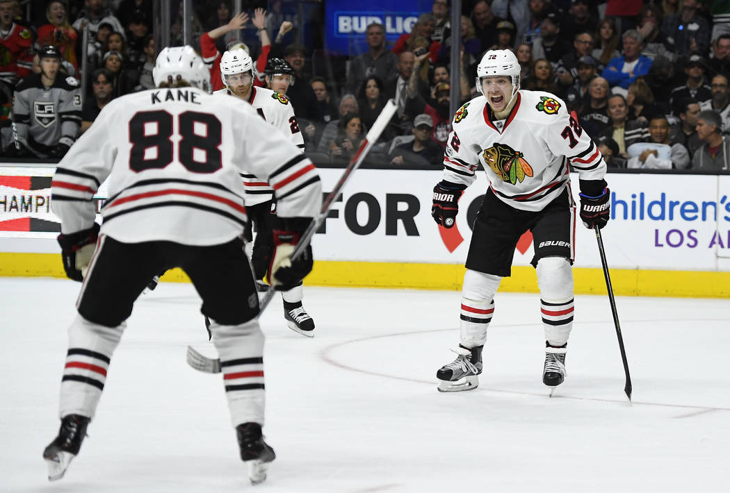 Chicago Blackhawks left wing Artemi Panarin, right, of Russia, celebrates his goal with right wing Patrick Kane during the third period of the team's NHL hockey game against the Los Angeles Kings, ...