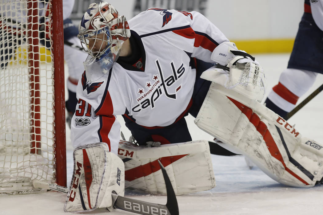 Washington Capitals goalie Philipp Grubauer, of Germany, looks to stop a shot against the Colorado Avalanche in the first period of an NHL hockey game Wednesday, March 29, 2017, in Denver. (David  ...