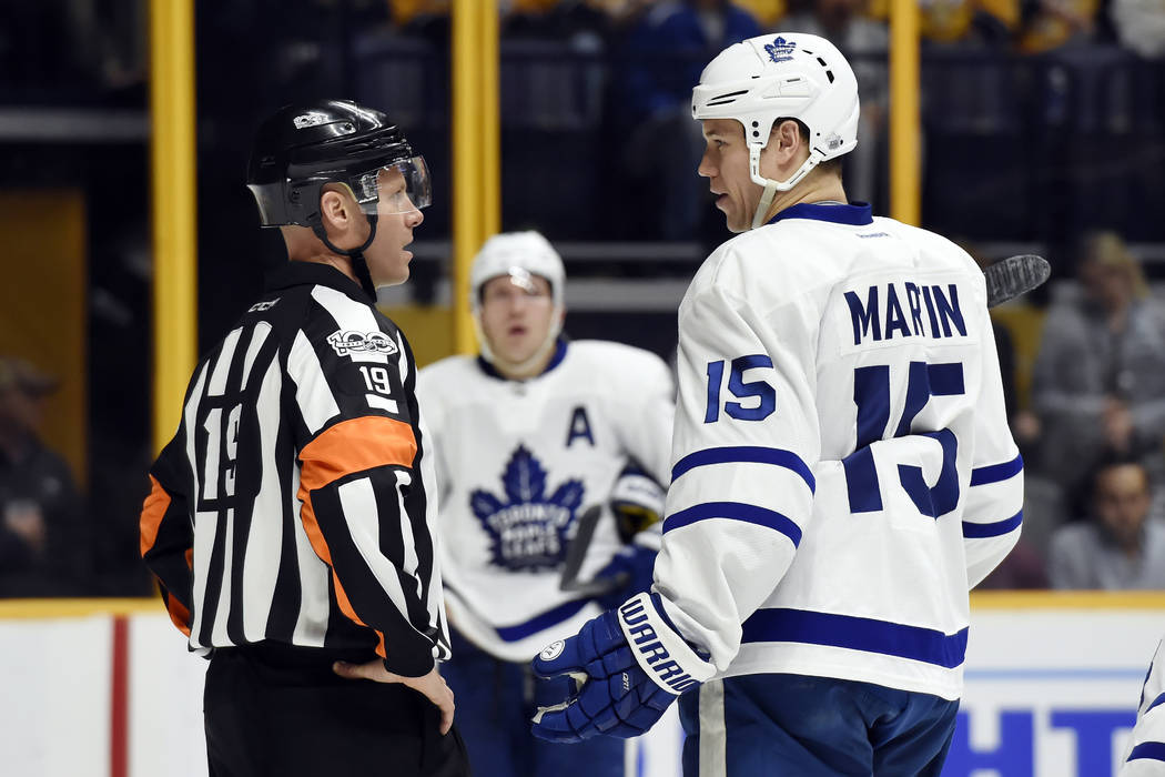 Toronto Maple Leafs left wing Matt Martin (15) talks with referee Gord Dwyer (19) during the second period of an NHL hockey game against the Nashville Predators Thursday, March 30, 2017, in Nashvi ...