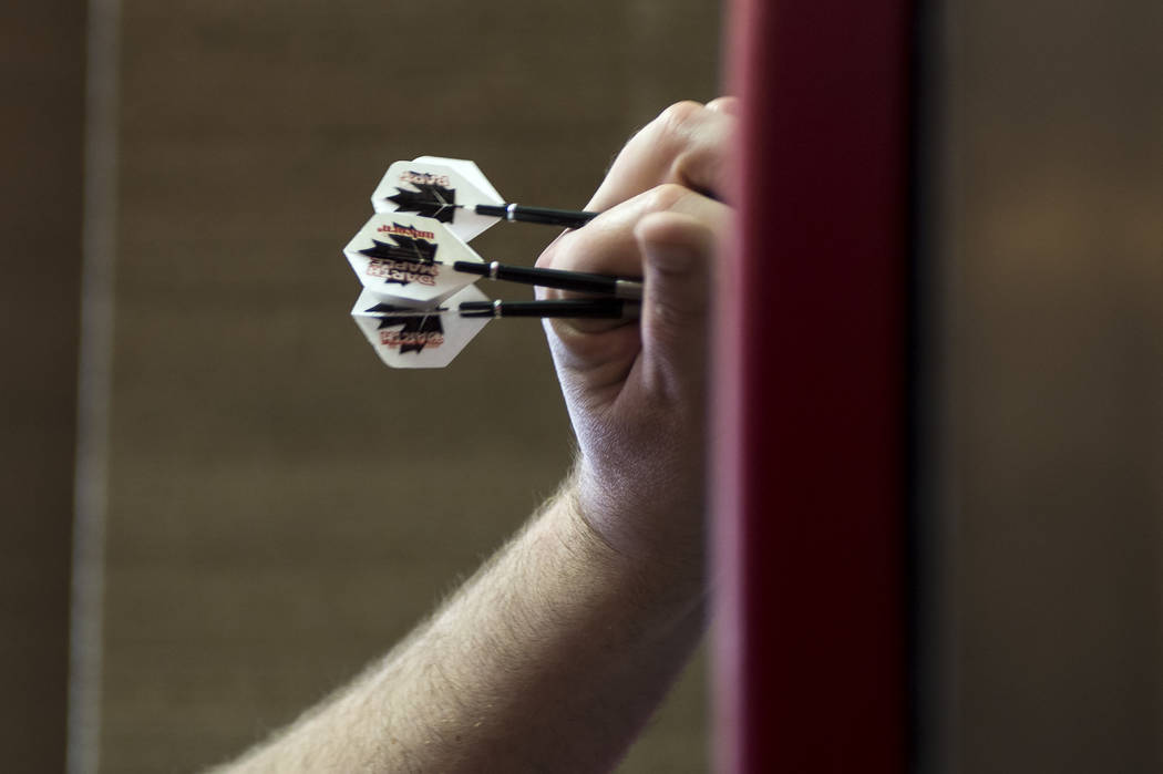 "Professional darts player John ""Darth Maple"" Part removes darts from the board after demonstrating how he plays on Wednesday, April 12, 2017, at Tropicana hotel-casino in Las Vegas. Tropicana will ..."