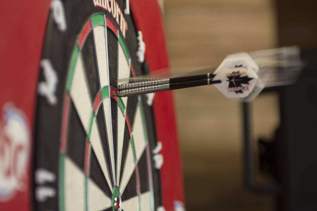 "A dart flies into the board as Professional darts player John ""Darth Maple"" Part demonstrates how he plays on Wednesday, April 12, 2017, at Tropicana hotel-casino in Las Vegas. Tropicana will be h ..."