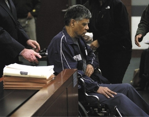 Dr. Dipak Desai appeared in a wheelchair during a court hearing on Thursday, March 7, 2013 before District Judge Valerie Adair. (Las Vegas Review-Journal)