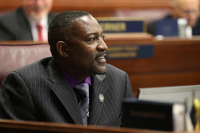 Assemblyman Tyrone Thompson, D-North Las Vegas, works on the Assembly floor during the final hours of the 77th Legislative session. He is a key proponent of the ban-the-box effort to remove barrie ...