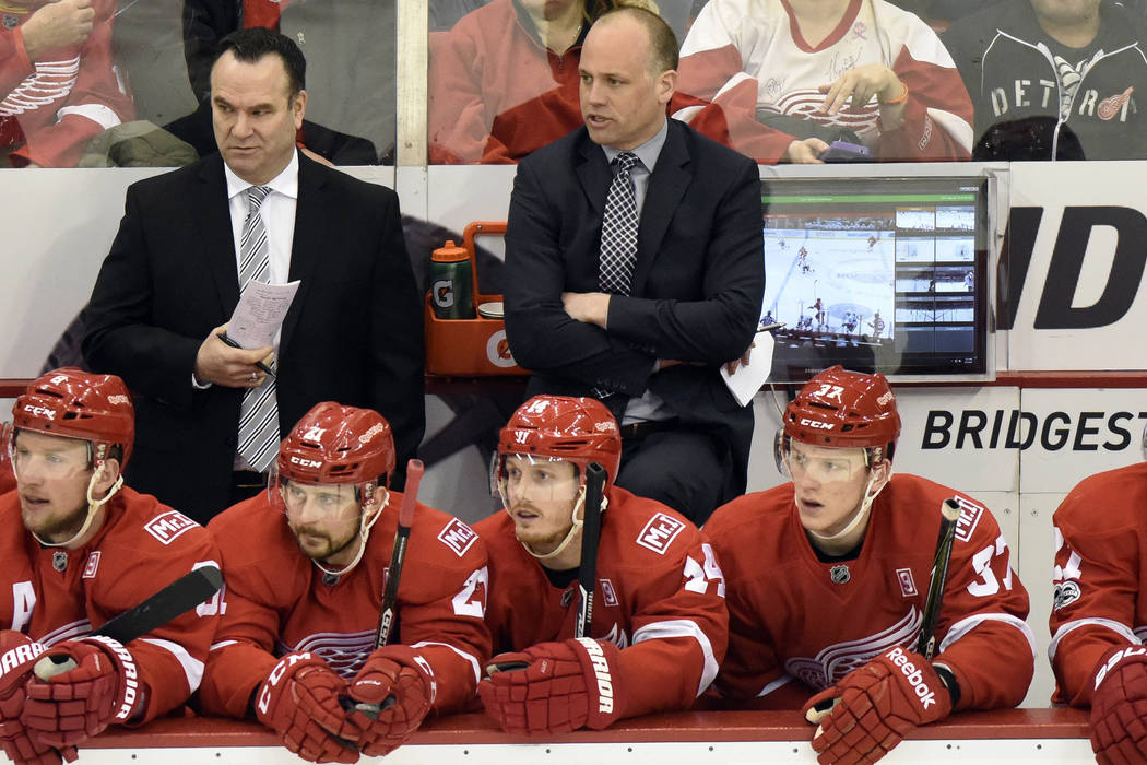 Detroit Red Wings head coach Jeff Blashill, center background, watches his team play against the Ottawa Senators during the first period of an NHL hockey game, Monday, April 3, 2017, in Detroit. ( ...