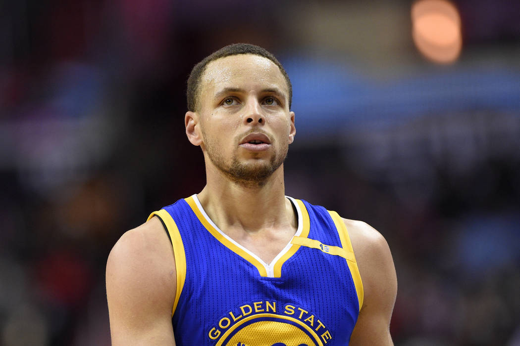 Golden State Warriors guard Stephen Curry (30) looks on during the second  half of