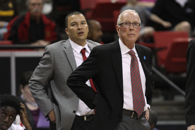 San Diego State head coach Steve Fisher and assistant coach Justin Hutson watch the action during the first half of their Mountain West Conference tournament quarterfinal game against UNLV Thursda ...
