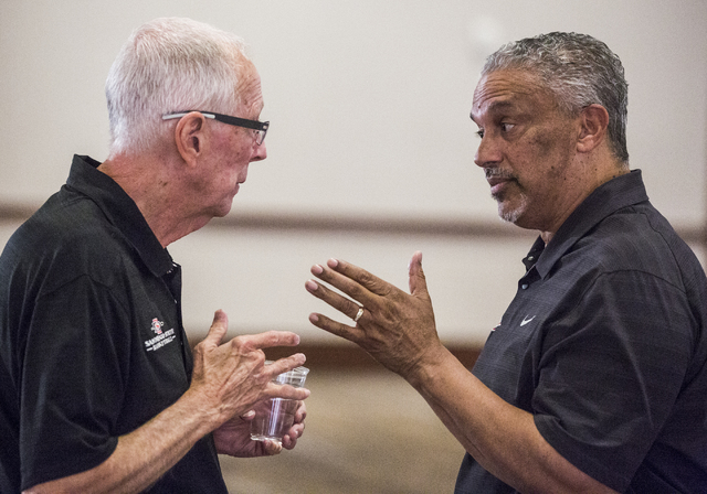 UNLV men's basketball coach Marvin Menzies, left, and San Diego State head coach Steve Fisher chat  during the Men's Basketball Media Day at the Renaissance Las Vegas Hotel on Wednesday, Oct.12, 2 ...