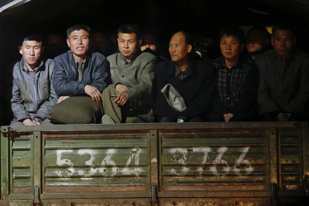 Men ride at the back of a truck in central Pyongyang, North Korea April 11, 2017.  REUTERS/Damir Sagolj