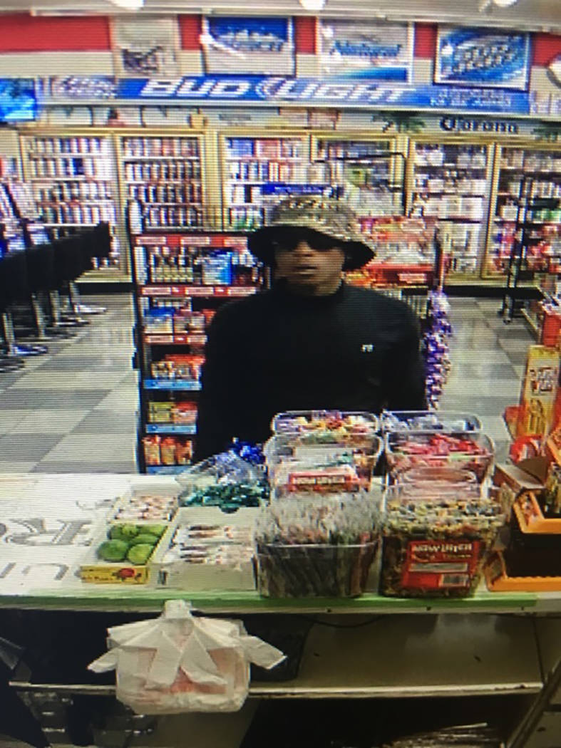 Police are looking for a thinly built man standing between 5 feet 9 inches and 6 feet tall suspected of a Monday night convenience store robbery in the northwest valley. (Metropolitan Police Depar ...