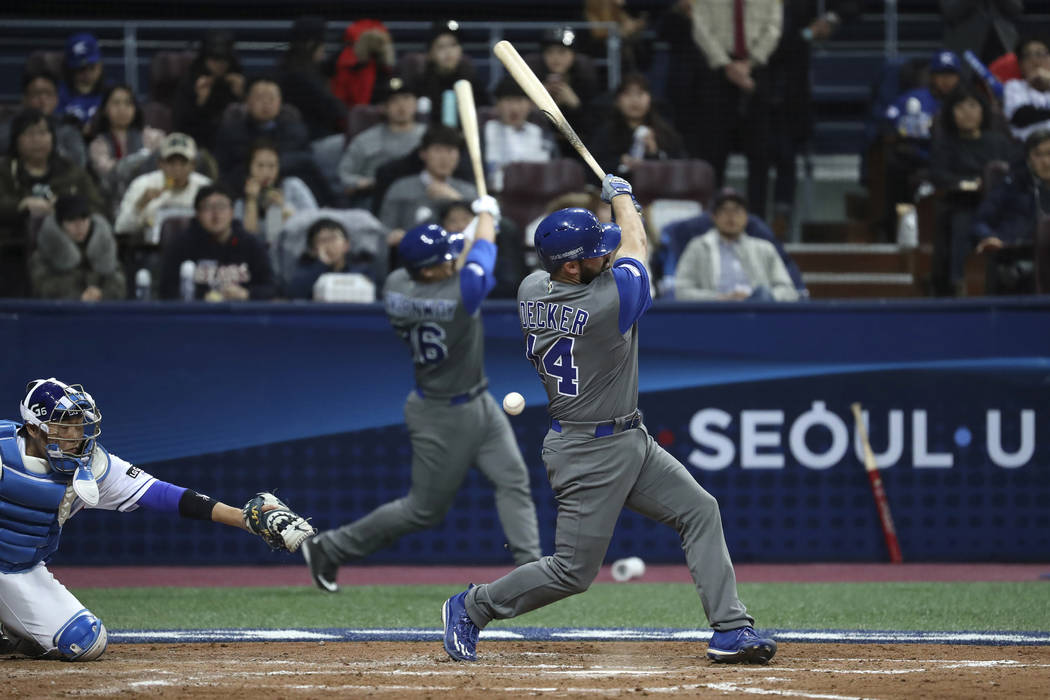 Israel's designated hitter Cody Decker, foreground, fouls off a pitch against South Korea during the fourth inning of their first round game of the World Baseball Classic at Gocheok Sky Dome in Se ...