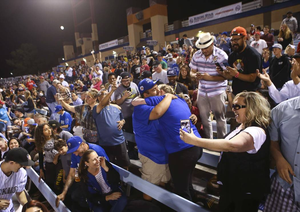 Las Vegas 51s fan Jesus Reyes hugs Hailey Fager after proposing to her during the opening day game against the Fresno Grizzlies at Cashman Field in Las Vegas on Tuesday, April 11, 2017. Chase Stev ...