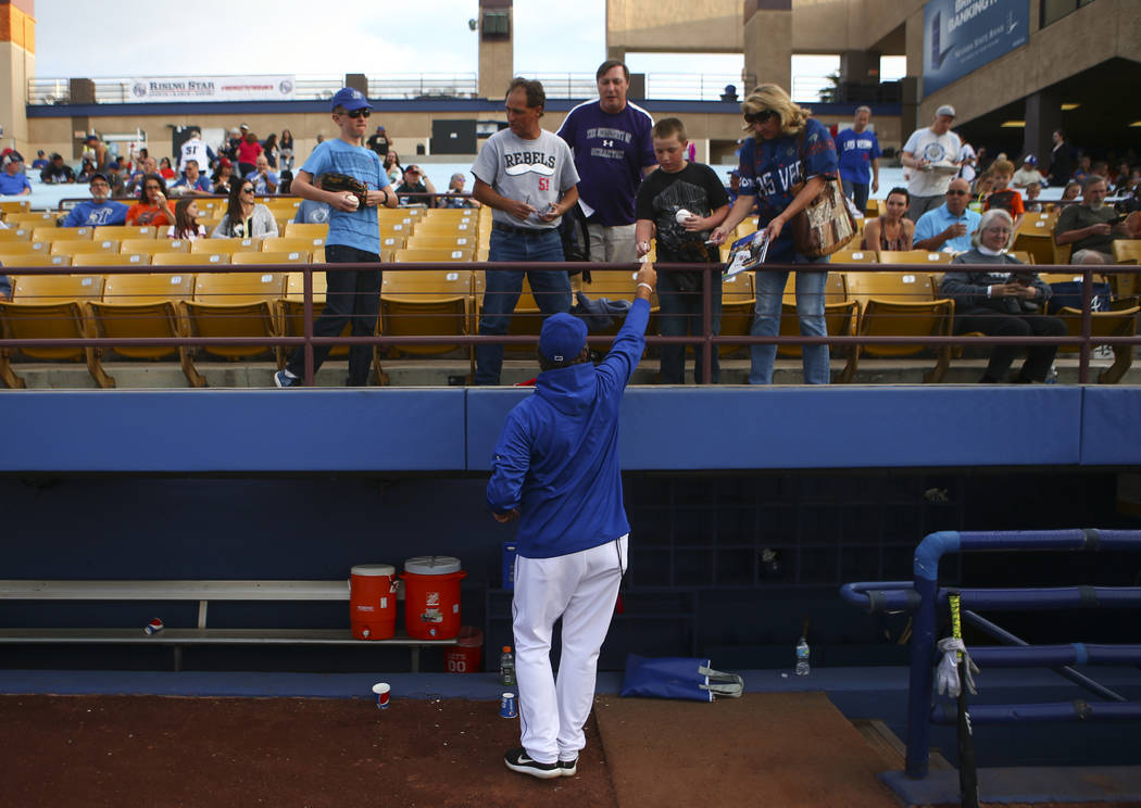 Las Vegas 51s pitching coach Frank Viola (34) signs autographs for fans before the start of the opening day game against the Fresno Grizzlies at Cashman Field in Las Vegas on Tuesday, April 11, 20 ...
