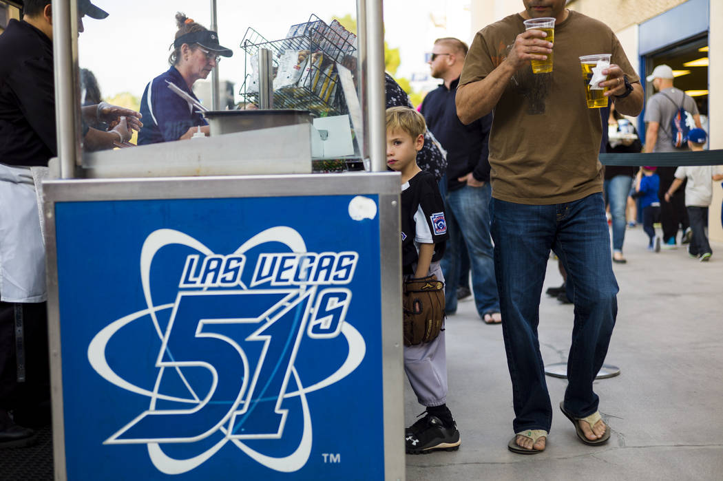 A young Las Vegas 51s fan looks on before the start of the opening day game against the Fresno Grizzlies at Cashman Field in Las Vegas on Tuesday, April 11, 2017. Chase Stevens Las Vegas Review-Jo ...