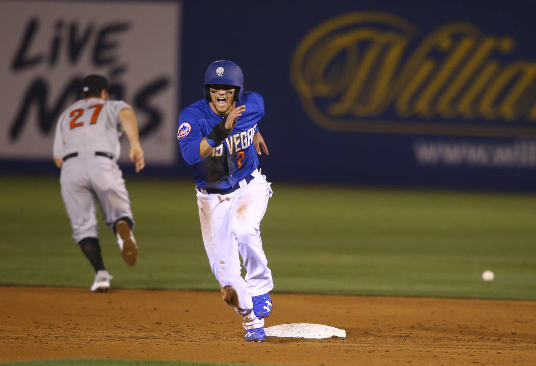 Las Vegas 51s infielder Gavin Cecchini (2) runs for third base during the opening day game against the Fresno Grizzlies at Cashman Field in Las Vegas on Tuesday, April 11, 2017. Chase Stevens Las  ...