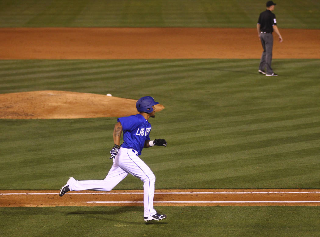Las Vegas 51s center fielder Desmond Jennings (8) runs on a triple hit that allowed three runs during the opening day game against the Fresno Grizzlies at Cashman Field in Las Vegas on Tuesday, Ap ...