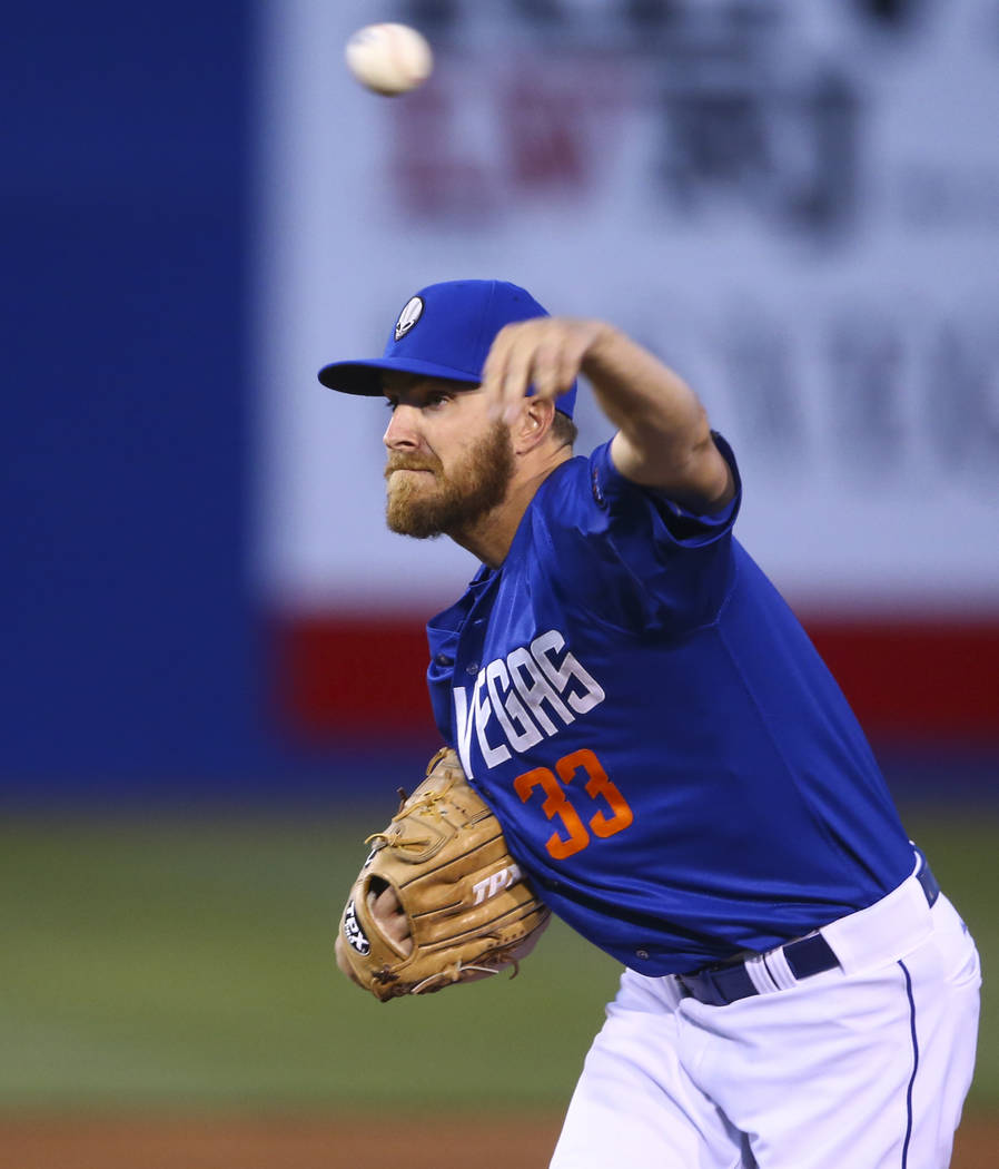 Las Vegas 51s pitcher Adam Wilk (33) pitches to Fresno during the opening day game at Cashman Field in Las Vegas on Tuesday, April 11, 2017. Chase Stevens Las Vegas Review-Journal @csstevensphoto