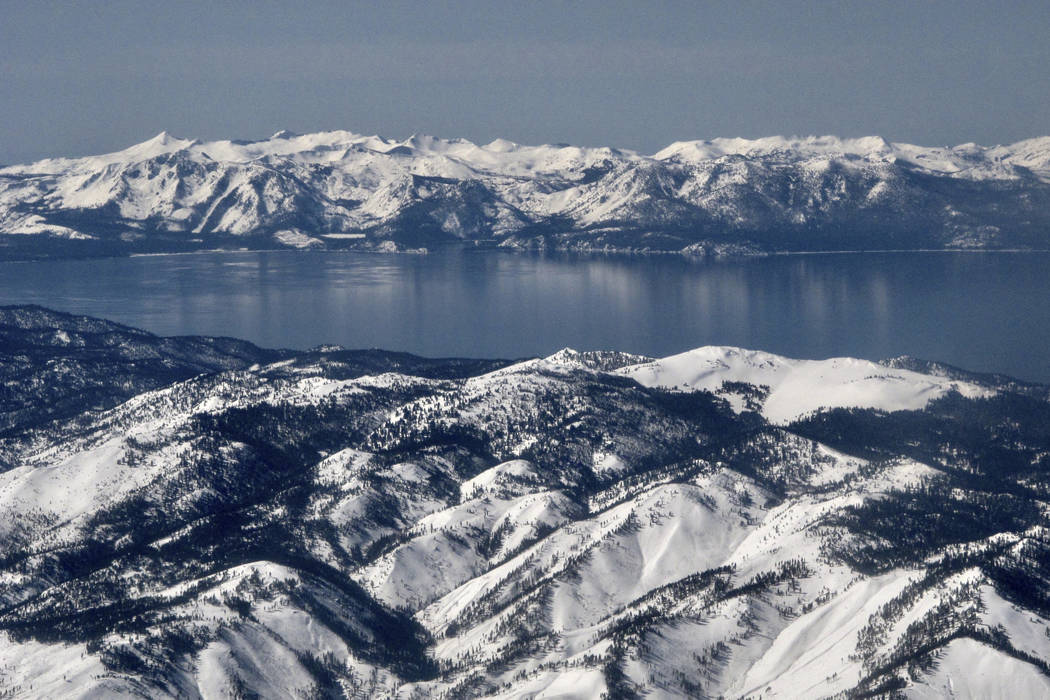 In this photo taken March 2, 2017, record winter snowfall is seen in the mountains around Lake Tahoe, in this aerial photo taken from above the Washoe Valley just south of Reno, Nev. (AP Photo/Sco ...