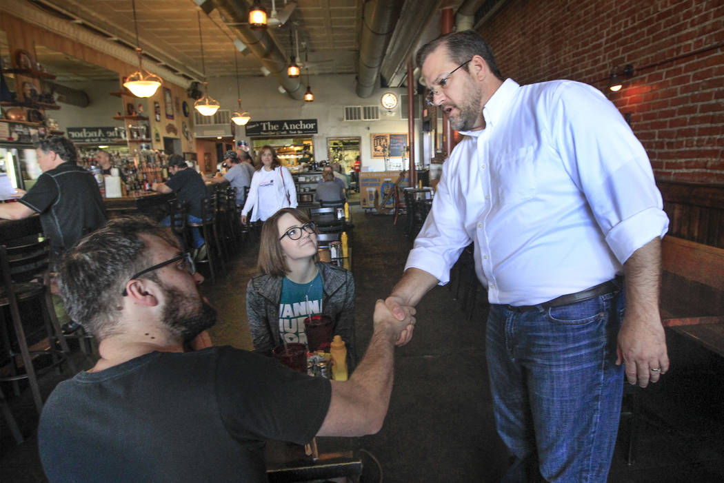 Kansas 4th District congressional Democratic candidate James Thompson, right, does some last-minute campaigning at The Anchor, a popular downtown restaurant, in downtown Wichita, Kan., over luncht ...
