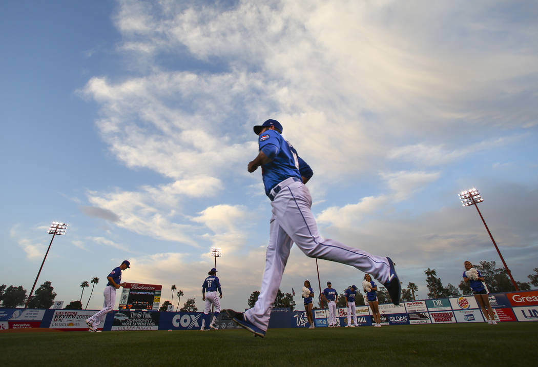 Las Vegas 51s pitcher Chasen Bradford (29), a 2008 graduate of Silverado High School, takes the field before the start of the opening day game against the Fresno Grizzlies at Cashman Field in Las  ...