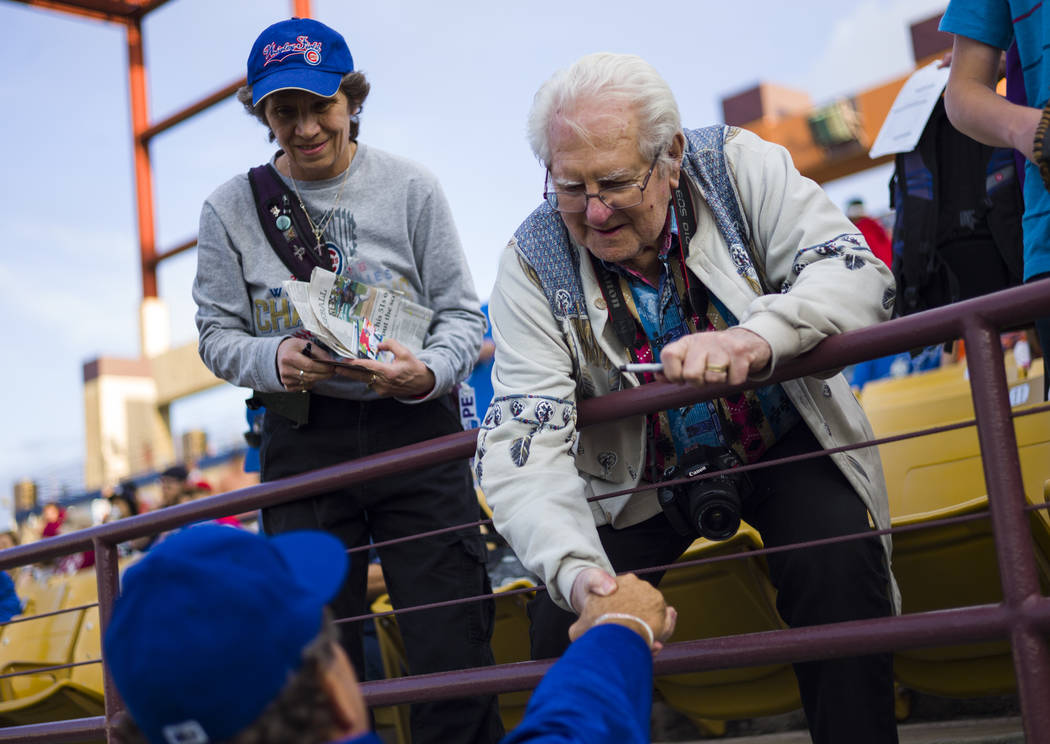 Las Vegas 51s fan Jack Zapola, who has been attending 51s games for over 20 years, greets pitching coach Frank Viola (34) before the start of the opening day game against the Fresno Grizzlies at C ...