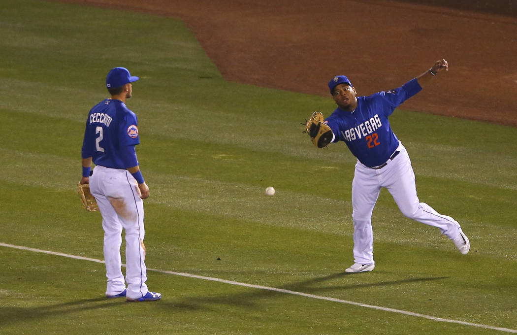 Las Vegas 51s infielder Dominic Smith (22) misses a fly ball from the Fresno Grizzlies during the opening day game at Cashman Field in Las Vegas on Tuesday, April 11, 2017. Chase Stevens Las Vegas ...