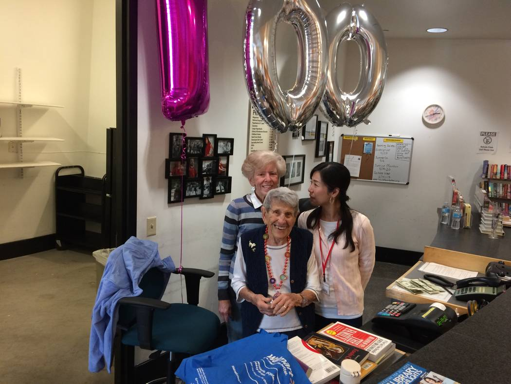 Gladys Stroud pauses March 24, 2017, with fellow bookstore workers Fran Clagett and Amike Tange. The balloons overhead mark Stroud's 100th birthday. When she lived in California, she took a part ...