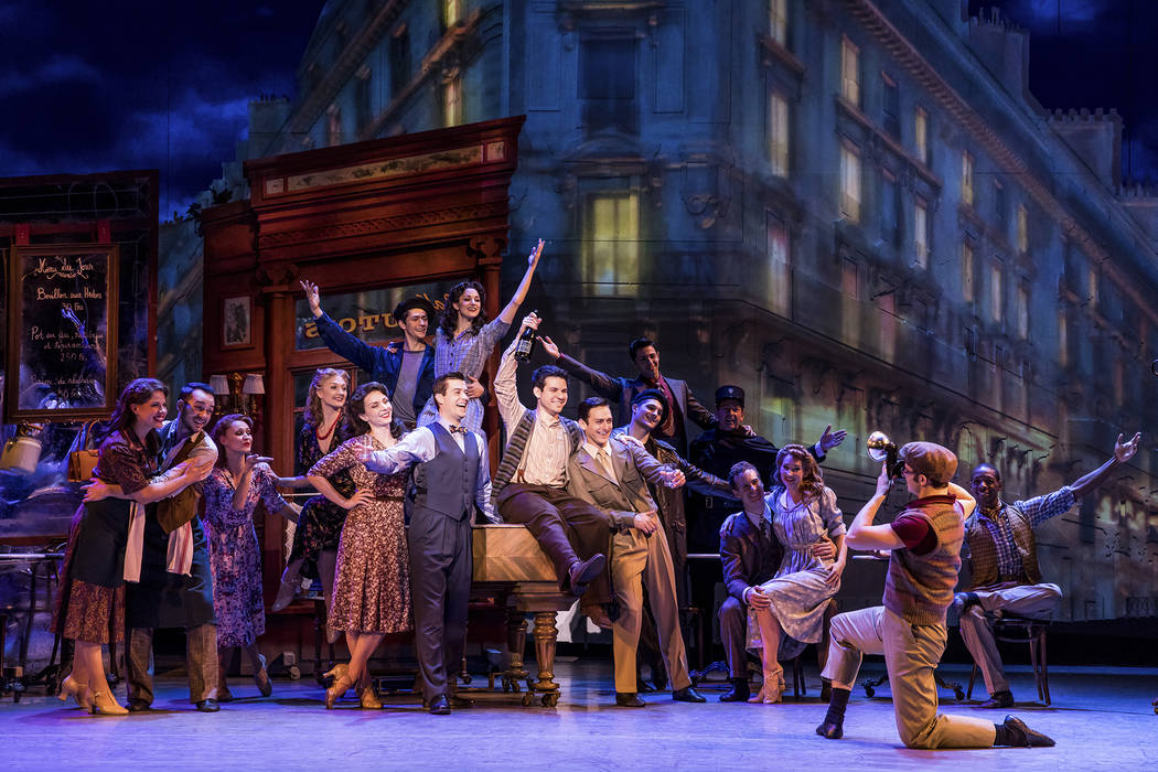 """Ex-GIs Adam Hochberg and Jerry Mulligan (Etai Benson, Garen Scribner), center, celebrate their new life in """"An American in Paris,"""" in performance at The Smith Center. (Matthew Murphy The Smith ..."""