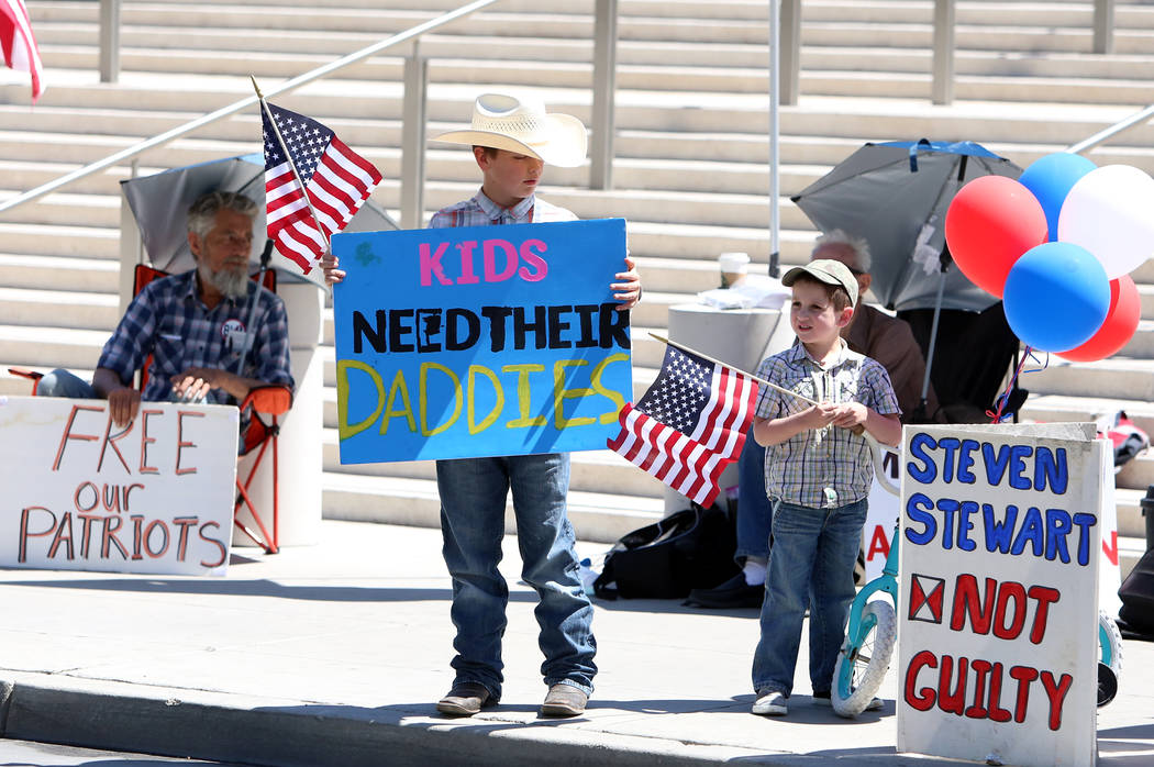 Bronco Bundy, center, 9, and his brother Payton, 5, outside Lloyd George Federal Building where lawyers give closing arguments in the first Bunkerville standoff trial on Wednesday, April 12, 2017, ...