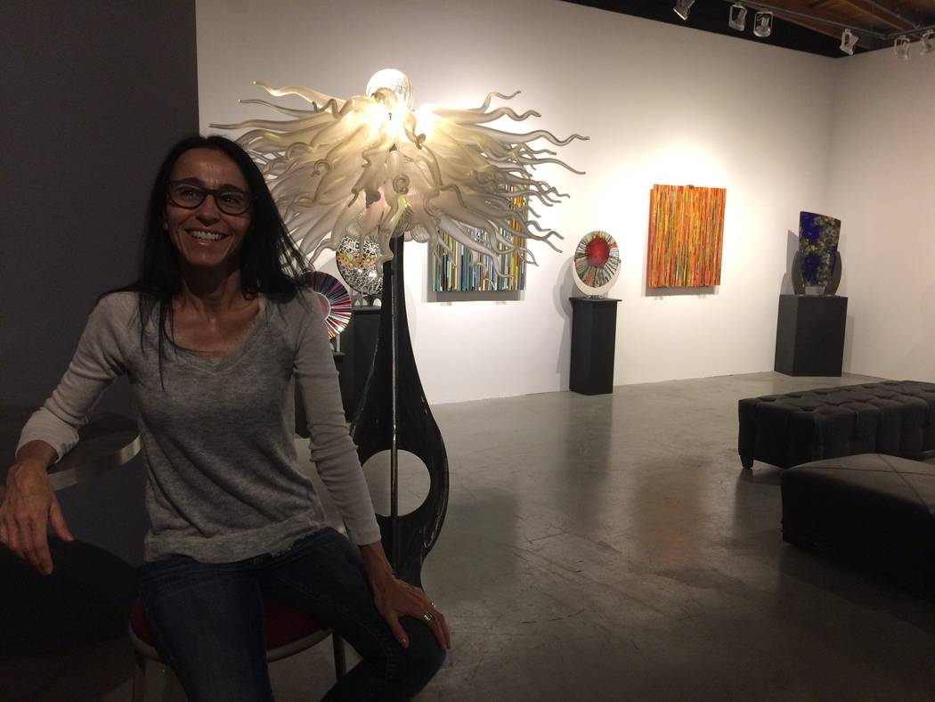Barbara Domsky poses with one of the pieces for sale in the shop April 7, 2017, at Domsky Glass, 2758 S. Highland Drive. She and her husband, Larry, usual make commissioned pieces but wanted local ...