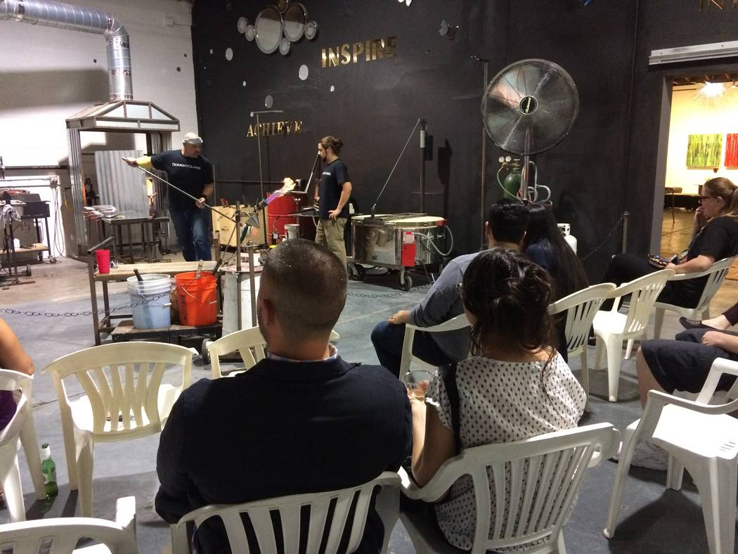Attendees at a glass blowing demonstration were kept well back from the 2,200-degree ovens where glass was melted to create artistic pieces. Domsky Glass is opening up its studio one weekend a mon ...