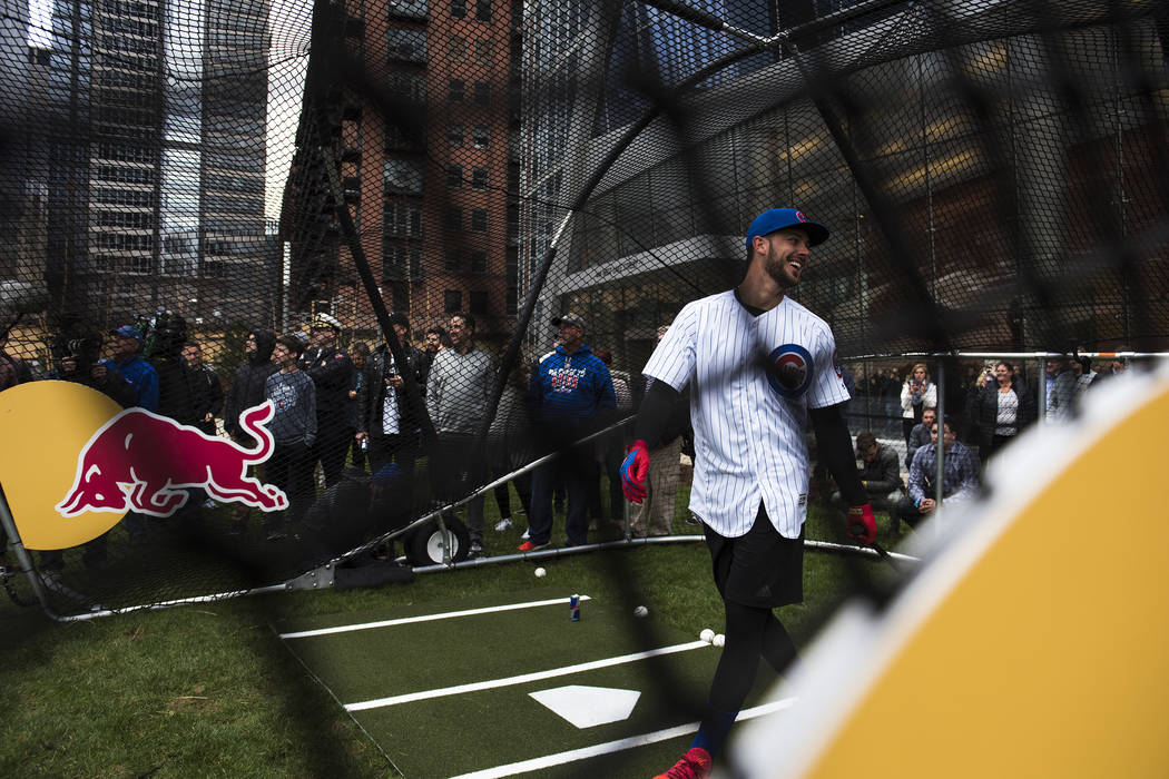 Kris Bryant does some batting practice in the streets of Downtown Chicago on April 11, 2017. (Ryan Taylor/Red Bull Content Pool via Reuters)
