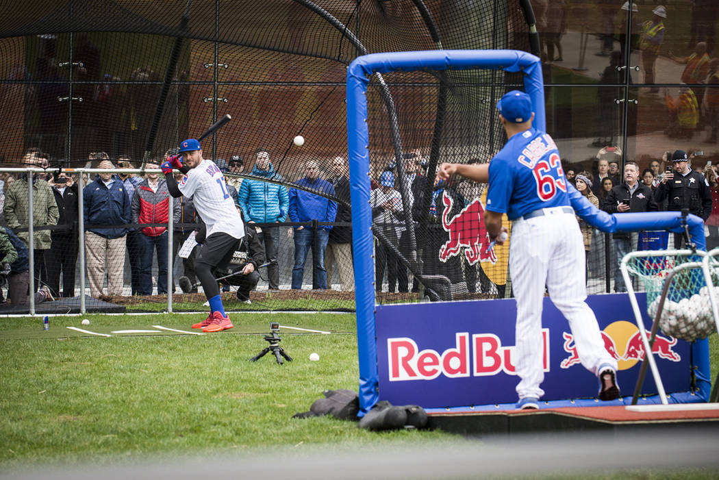 Kris Bryant does some batting practice in the streets of Downtown Chicago on April 11, 2017. (Red Bull)