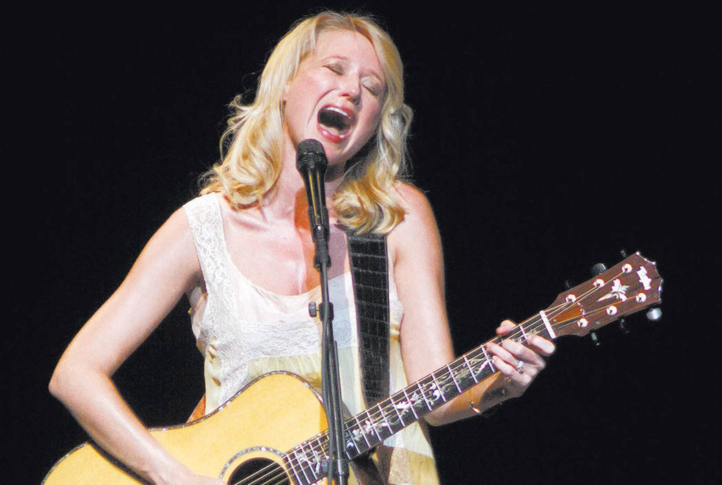 Singer songwriter Jewel, born Jewel Kilcher, during her concert in her home state in Anchorage, Alaska Thursday Aug. 20, 2009. (AP Photo/Al Grillo)