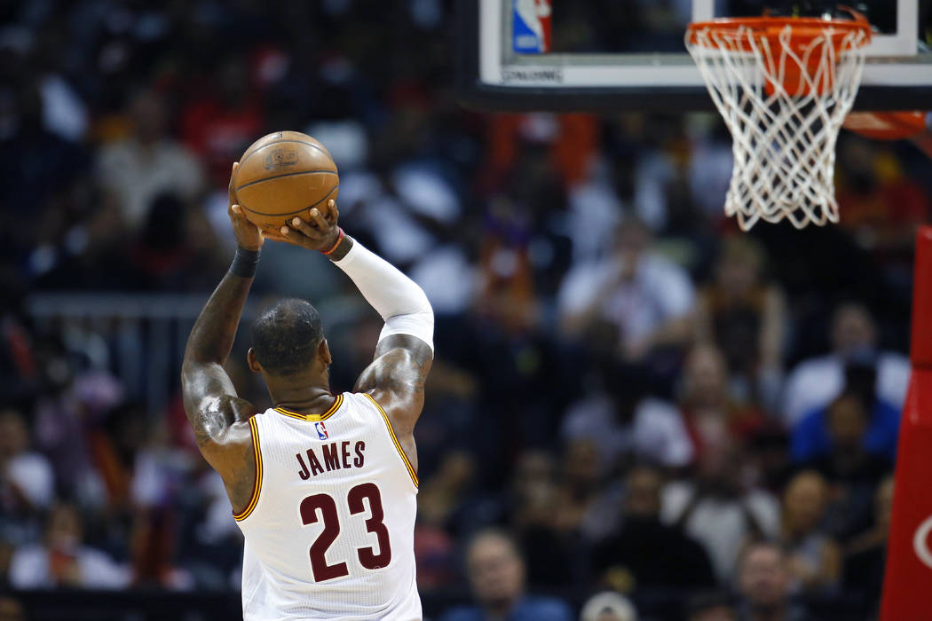 Cleveland Cavaliers forward LeBron James (23) shoots from the line in the first half of an NBA basketball game against the Atlanta Hawks, Sunday, April 9, 2017, in Atlanta. (Todd Kirkland/AP)