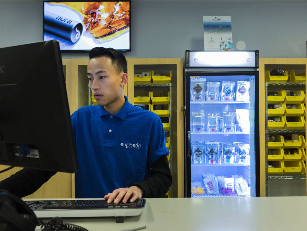 Bud tender Henson Nguyen works at Euphoria Wellness, a medical marijuana dispensary located in West Las Vegas, Thursday, April 13, 2017. Elizabeth Brumley Las Vegas Review-Journal @EliPagePhoto