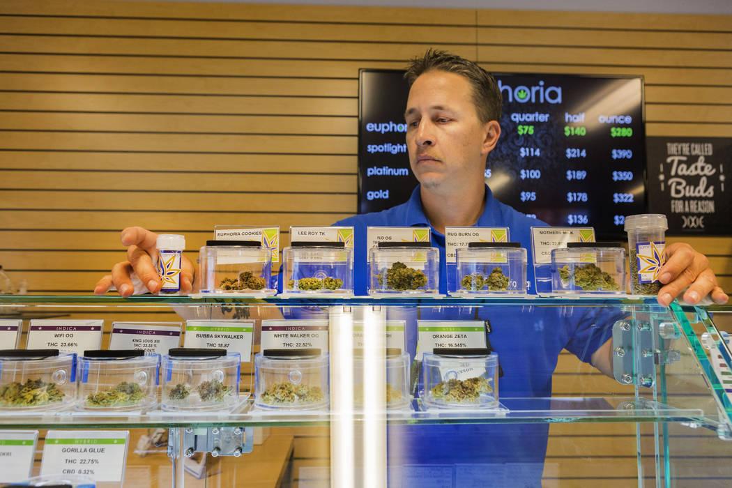 Bud tender Jayson Stutsman works at Euphoria Wellness, a medical marijuana dispensary located in West Las Vegas, Thursday, April 13, 2017. Elizabeth Brumley Las Vegas Review-Journal @EliPagePhoto