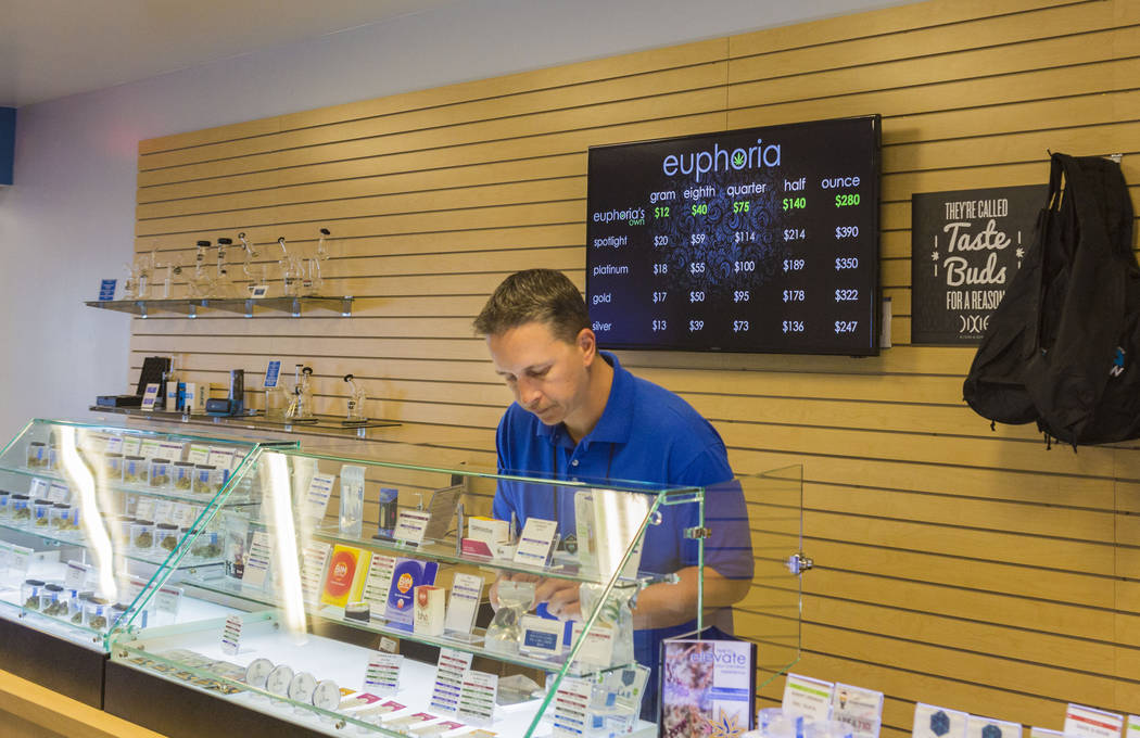 Bud tender Jayson Stutsman works at Euphoria Wellness, a medical marijuana dispensary located in West Las Vegas, Thursday, April 13, 2017. Elizabeth Brumley Las Vegas Review-Journal @EliPagePhoto