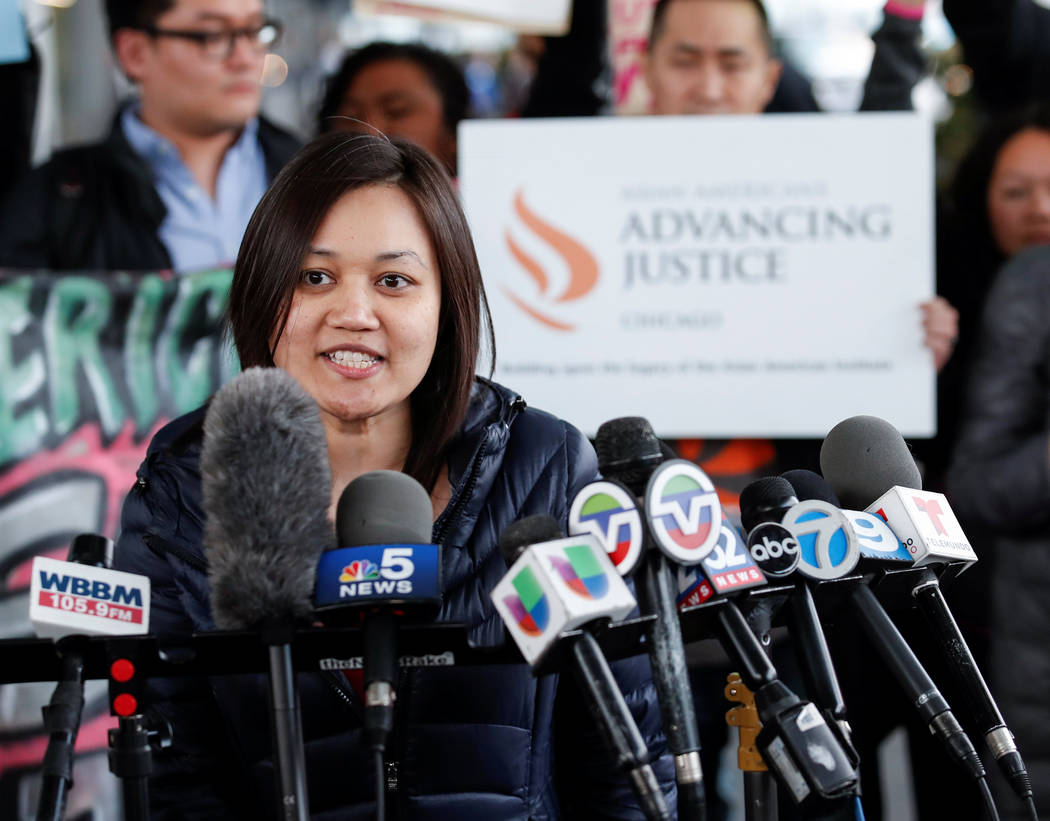 Tuyet M. Le, Executive Director of Asian American Advancing Justice, speaks during a protest of the treatment of Dr. David Dao, who was forcibly removed from a United Airlines flight on Sunday by  ...