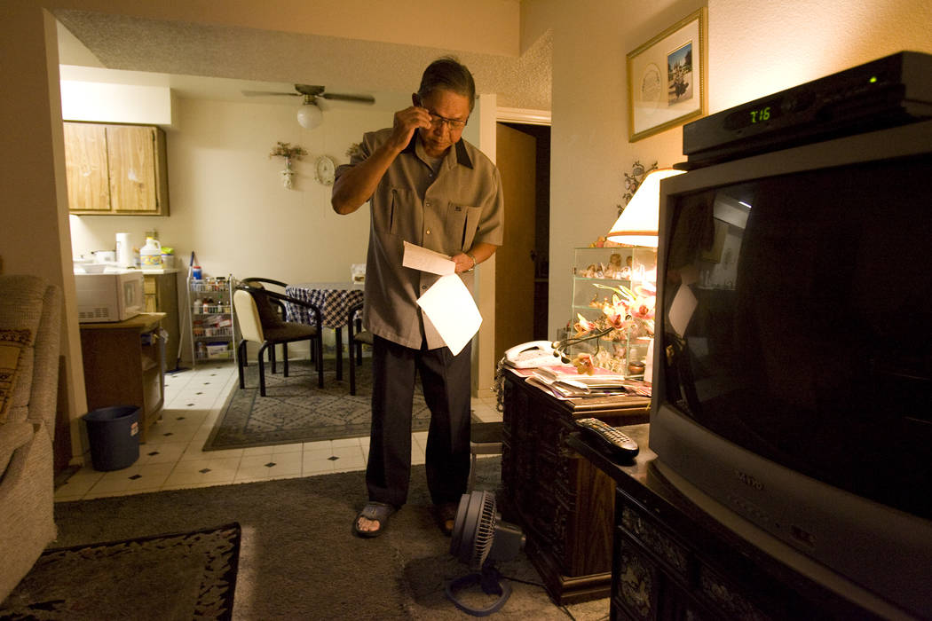 Rodolfo Meana, 73, goes through notes at his Las Vegas apartment Thursday, Aug. 14, 2008, regarding his experience at the Endoscopy Center of Southern Nevada where health authorities say he contra ...