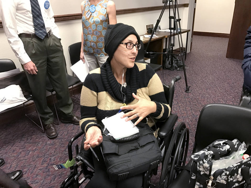 Stephanie Packer, a 34-year-old mother of four, talks with reporters after a press conference Wednesday, April 12, 2017, in Carson City. Packer, who has a terminal lung disease and is undergoing c ...