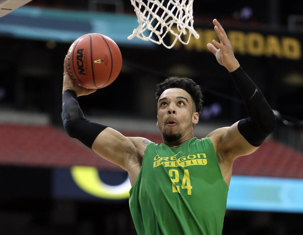 In this March 31, 2017, file photo, Oregon's Dillon Brooks dunks during a practice session for their NCAA Final Four tournament college basketball semifinal game in Glendale, Ariz. Brooks has anno ...