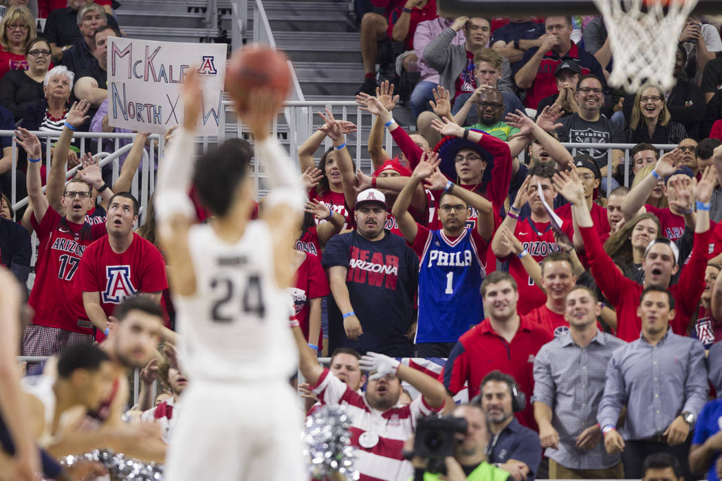 Arizona Wildcats fans get loud while a free-throw by Oregon Ducks forward Dillon Brooks (24) in an NCAA college basketball game for the Pac-12 tournament championship at T-Mobile Arena Saturday, M ...