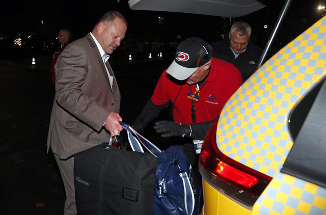 Gerard Gallant, former Florida Panthers head coach, gets into a cab after being relieved of his duties following an NHL hockey game against the Carolina Hurricanes, Sunday, Nov. 27, 2016, in Ralei ...