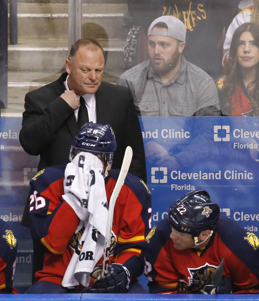 Florida Panthers head coach Gerard Gallant adjusts his collar during the second period of an NHL hockey game against the St. Louis Blues, Friday, Feb. 12, 2016 in Sunrise, Fla. (AP Photo/Wilfredo Lee)