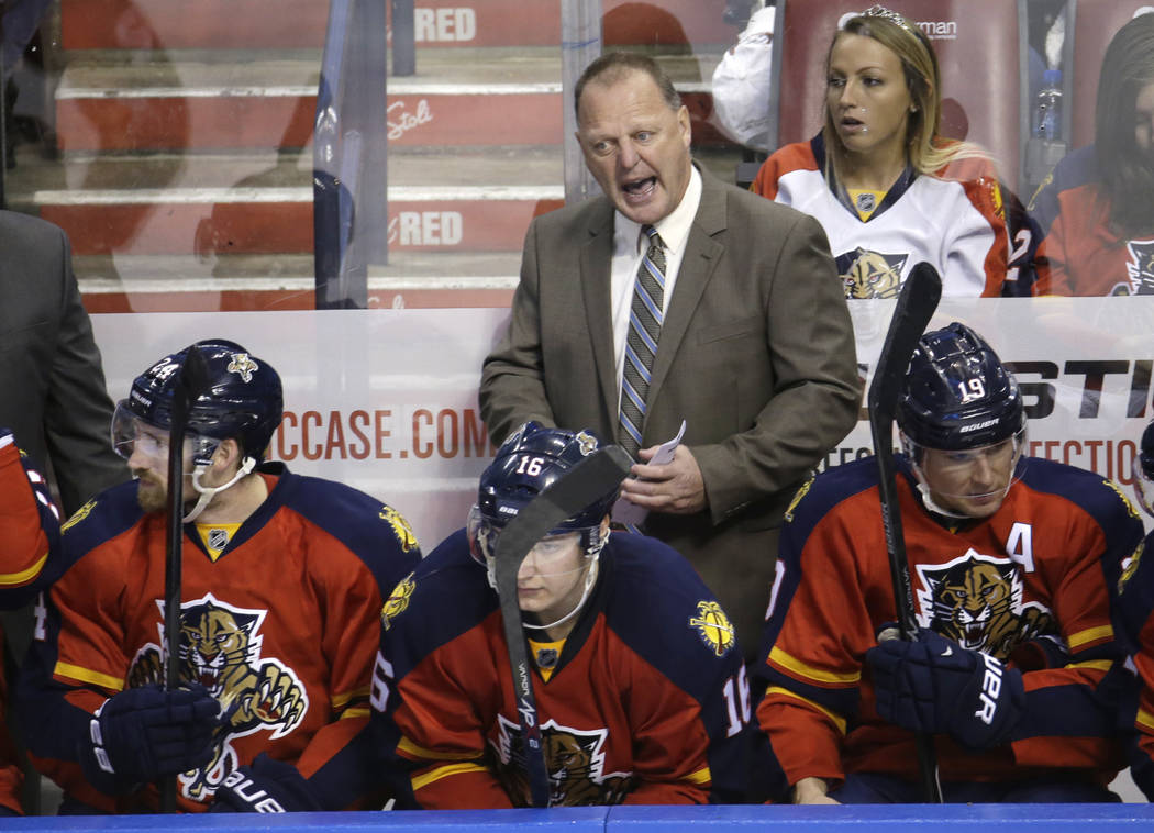 Florida Panthers head coach Gerard Gallant talks with his players in the third period of an NHL hockey game against the Edmonton Oilers, Saturday, Jan. 17, 2015, in Sunrise, Fla. (AP Photo/Lynne S ...