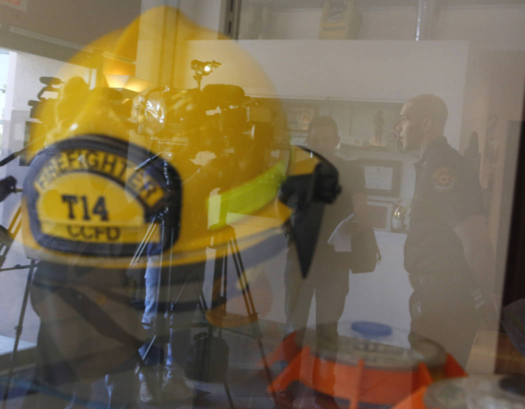 The reflection of Deputy Fire Chief Jeff Buchanan as he informs the public of bee safety at the Clark County Fire Department on Thursday, April 13, 2017, in Las Vegas. Christian K. Lee Las Vegas R ...